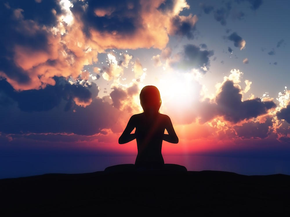 3D render of a female in a yoga pose against a sunset sky